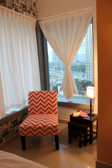 The is my guest room. Beautiful reading chair with a great view over looking to the Dubai Fountains