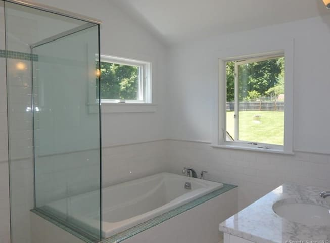 Luxurious soaking tub, glass shower in your private en-suite bathroom.
