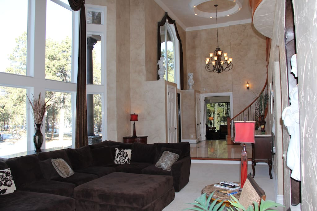 Grand Room, 22' ceilings, 70 oz cozy carpeting, Italian marble entry, surround system, Massive FP, TV, DVD, seating for 14.