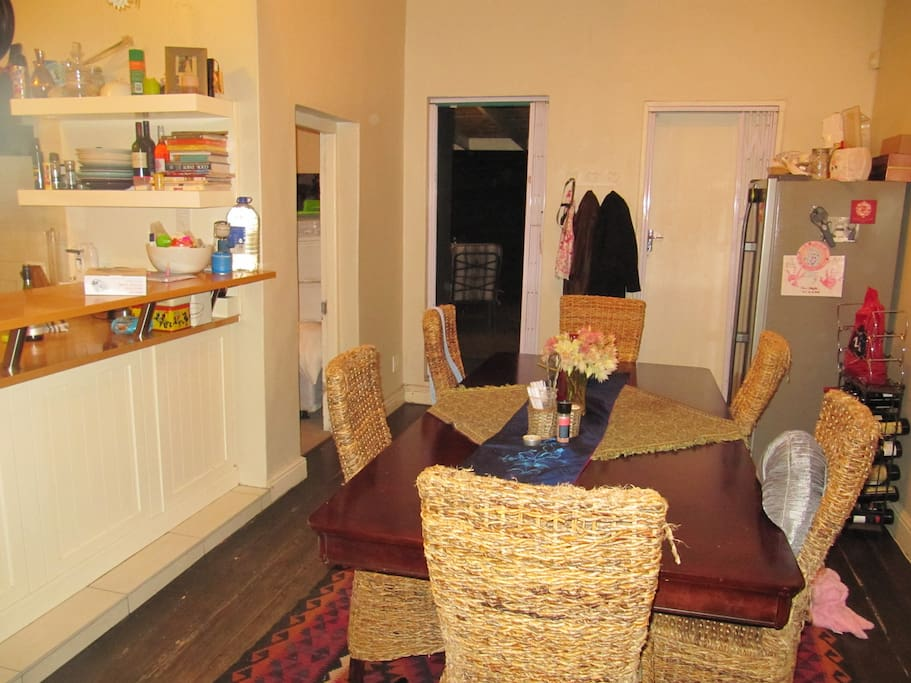 8 - 10 seater dining room table and spare double door fridge