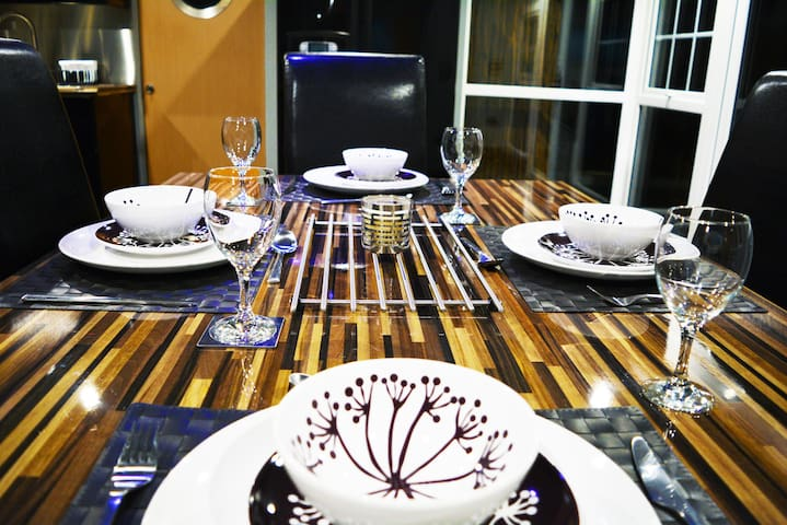 Dine With Style at Our Custom Designed Table - Seated View