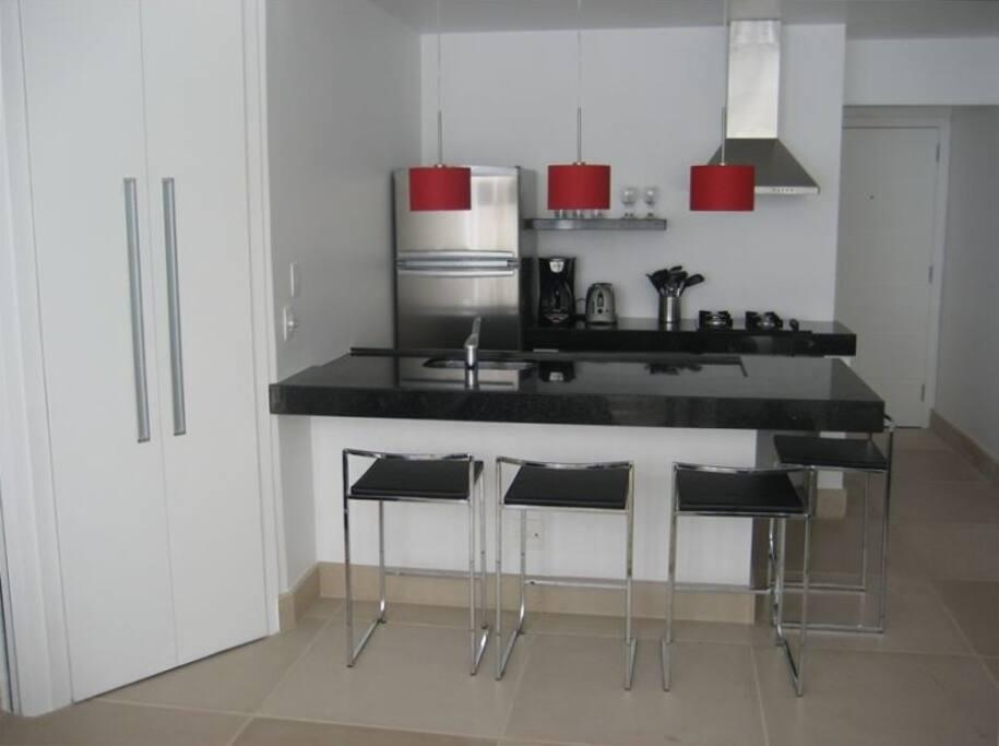 kitchen, fridge, coffee maker, microwave, stovetop