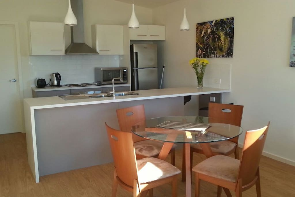 Fully equipped kitchen and dining room.