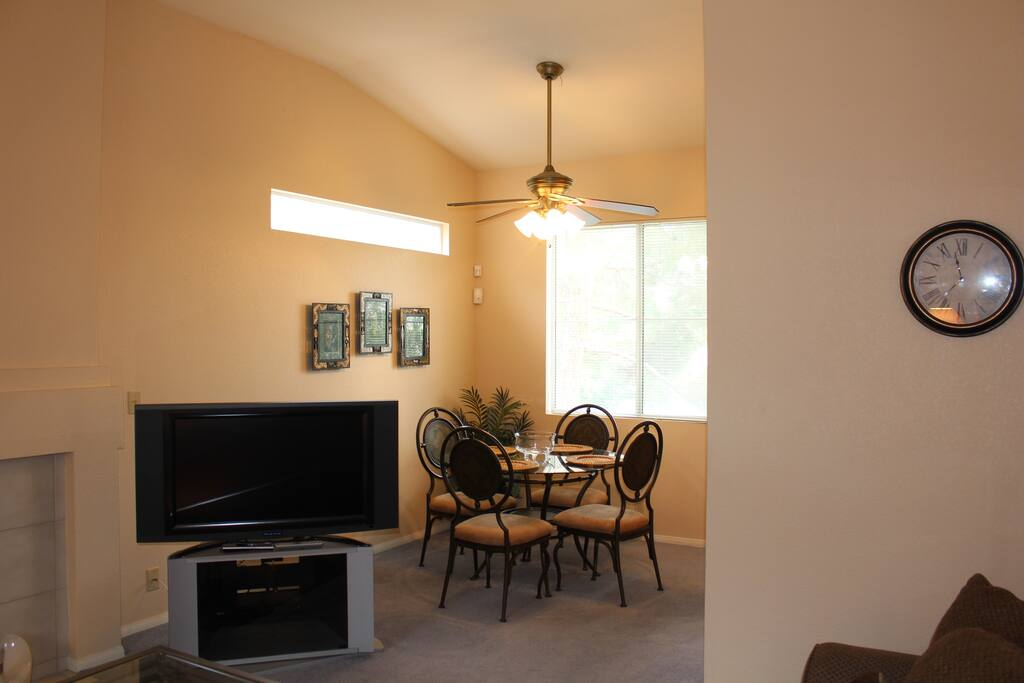 Plenty of natural sunlight. With cute 4 person dining table behind television and near kitchen