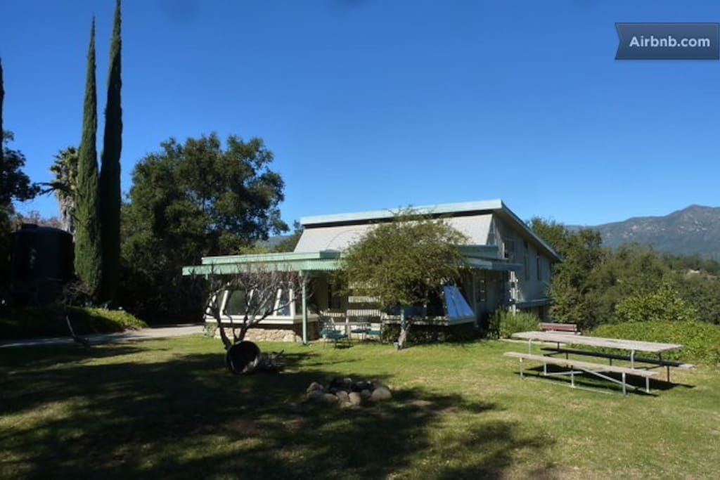 The Chalet sits on  the north side of the hill. A large yard with huge oaks, fruit trees occupies most of the hill top