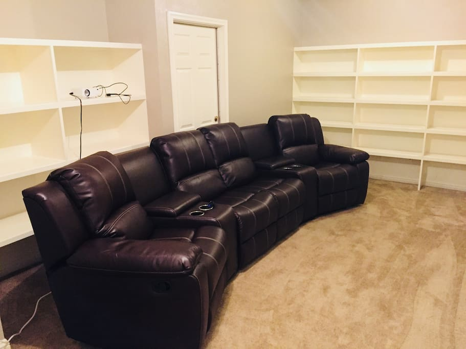 Theater Room with superb 5.1 SURROUND SOUND SYSTEM and all reclining sectionals