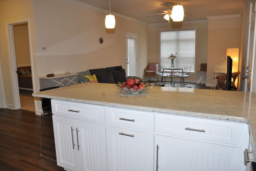 Great granite bar with 2 bar chairs.