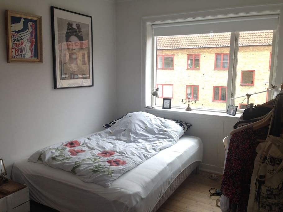 Double bed in a bright, yet cosy room