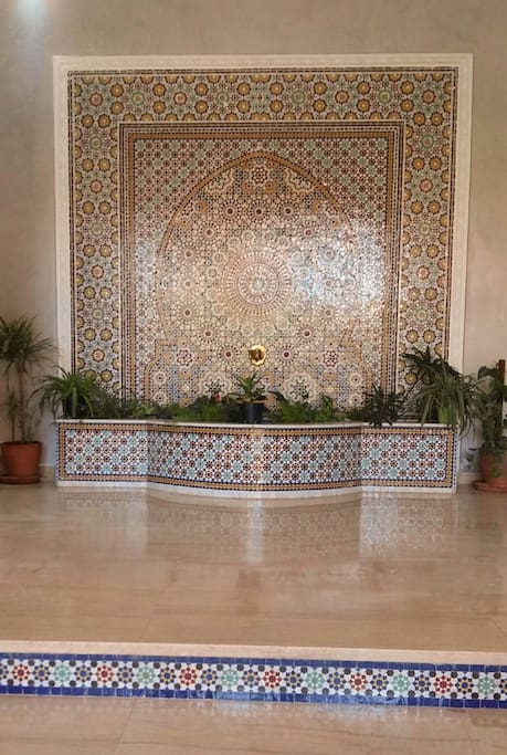 The building entrance's highlight: a fountain decorated with traditional Moroccan mosaics