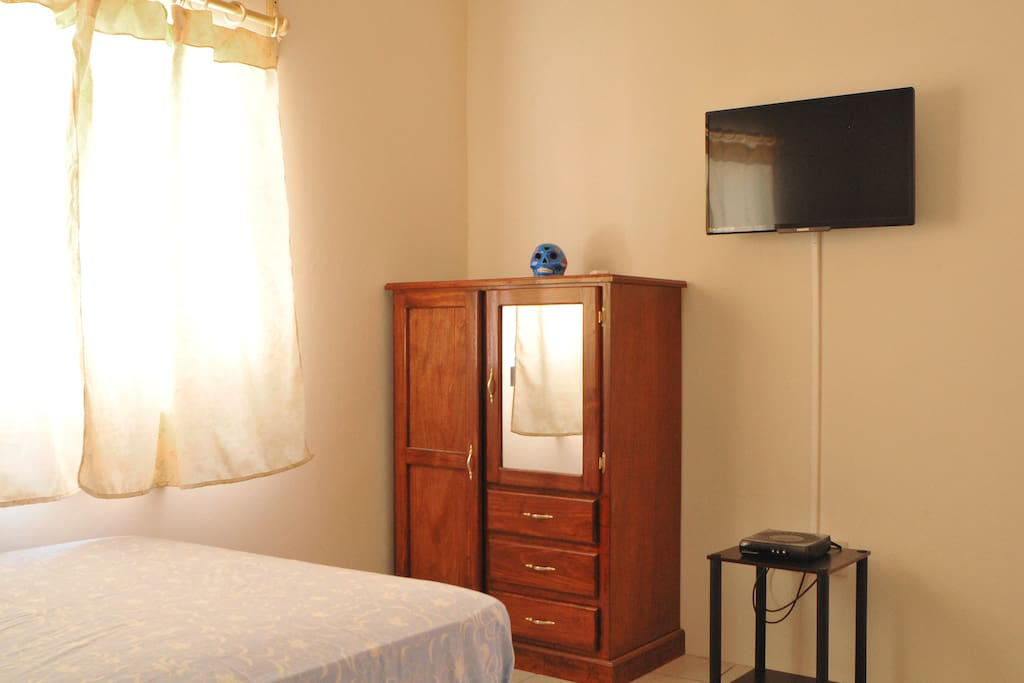 One double bed and one single bed  and air-conditioning unit.