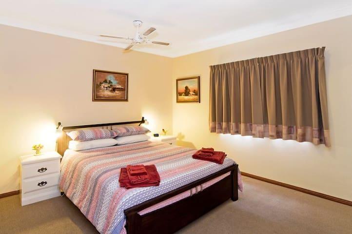 The main bedroom overlooking the pool. It has abundant wardrobe space with floor to ceiling mirror sliding doors.