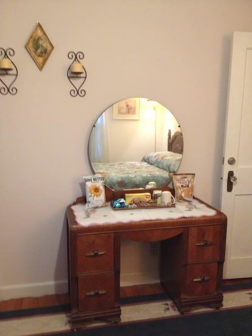 Vintage vanity/dresser in room.