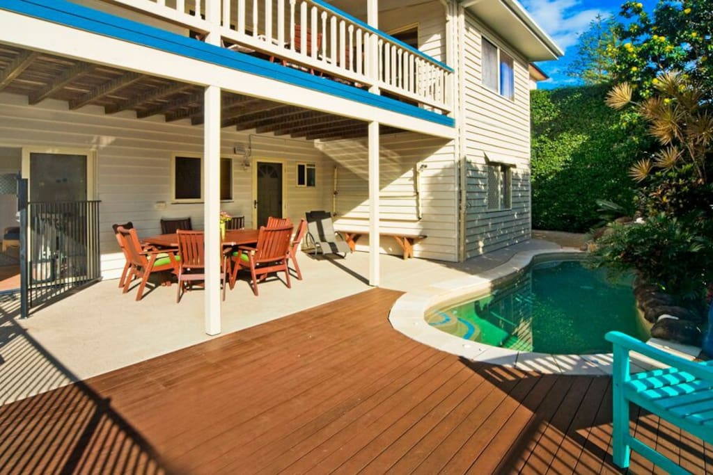 The pool and pool deck with a great outdoor table that seats 8 and a Webber Baby Q barbecue.