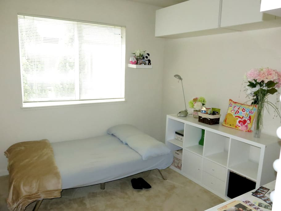 Clean and comfy room with fresh linens, pillows, and blankets