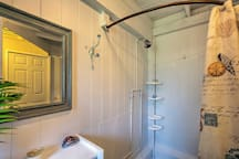 The bathroom has a walk-in shower to rinse off from the days adventures!