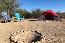 The Cosmic Campsite includes two chairs, a little table and your own little firepit.