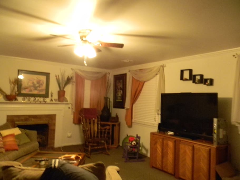 Family room include large screen TV and fireplace.