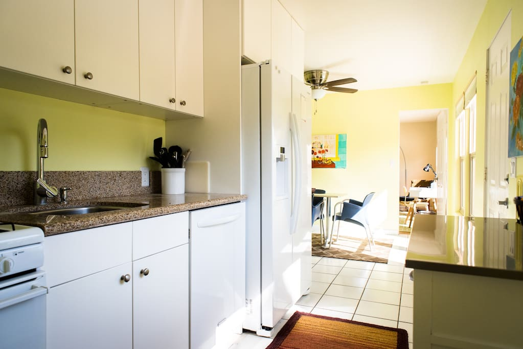 This unit has a full kitchen with a dishwasher
