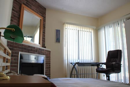 Very bright nice room with  fireplace and balcony. So private and cozy on the second floor of townhouse. Great locations. The  Home is not far from  public transportation and major freeways. Banks, supermarket and restaurants in the walking distance