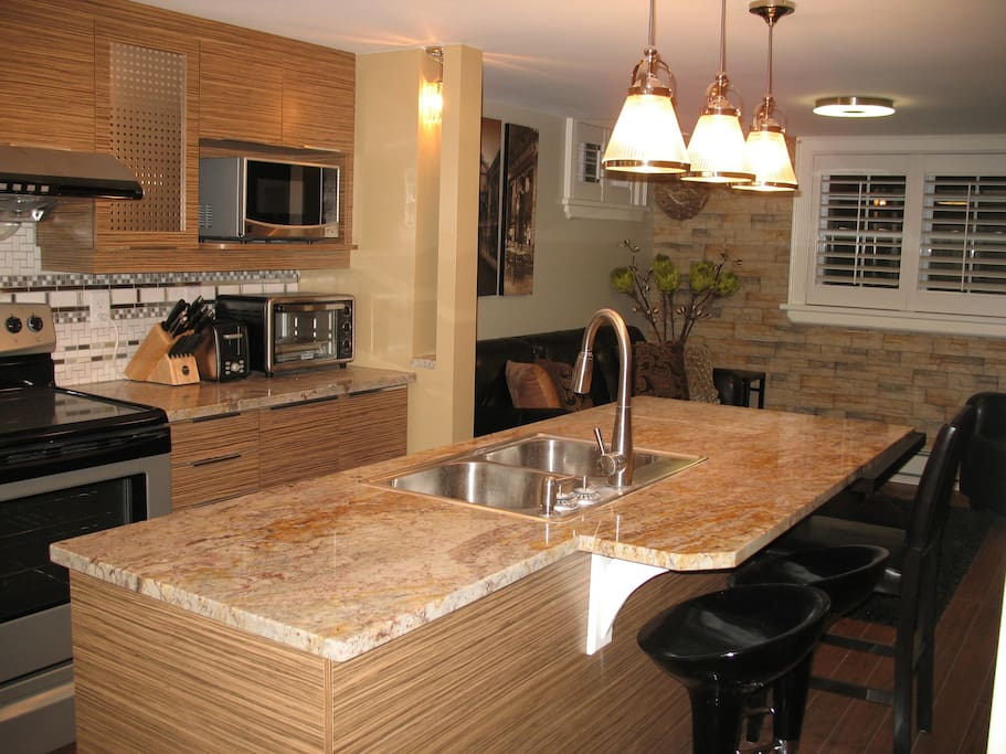 Modern Fully Equipped Kitchen with Granite Countertop