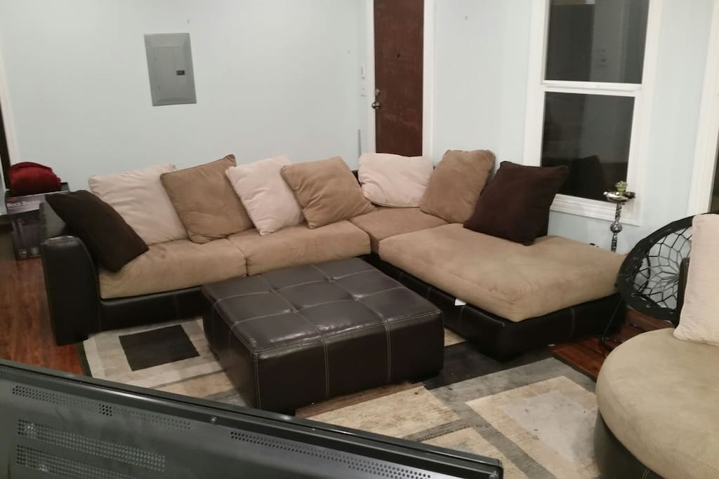 Large cozy comfortable L shaped couch (can be rented separately for cheaper!) with large swivel chair.   We use this space for hosting game nights and watch parties