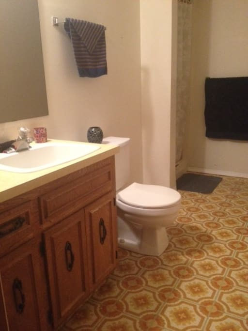 Private bathroom with shower right next to room in private hallway