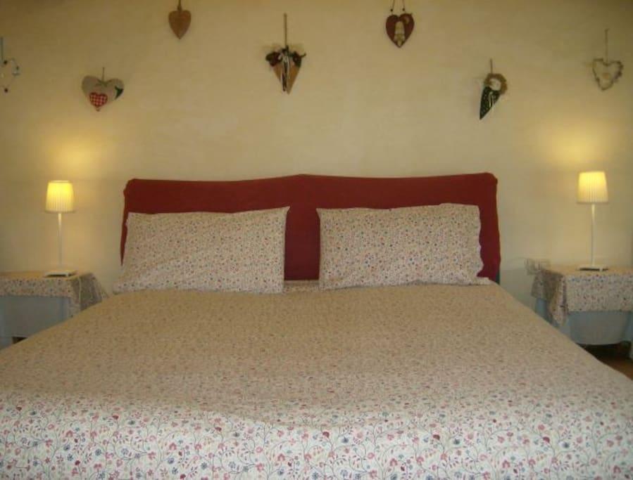 Camera scoiattolo con letto matrimoniale e 2 letti singoli