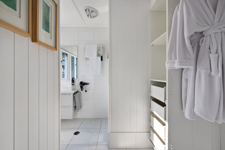 The fresh ensuite, with storage and walk in shower