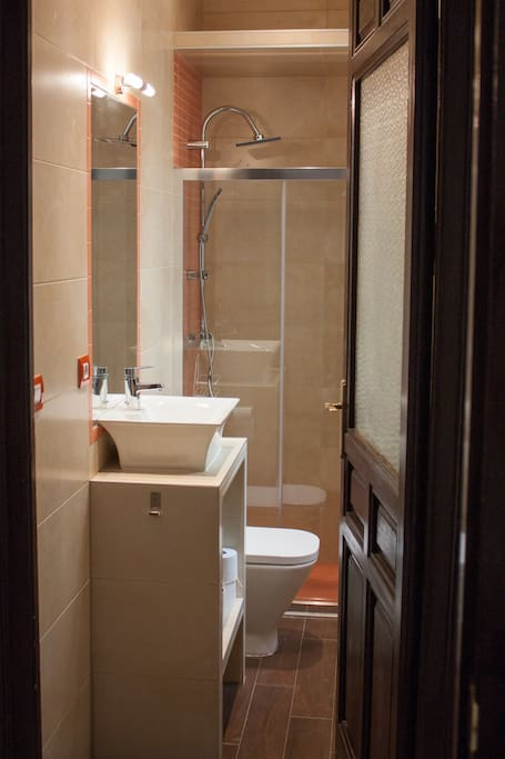 Shared bathroom with a shower
