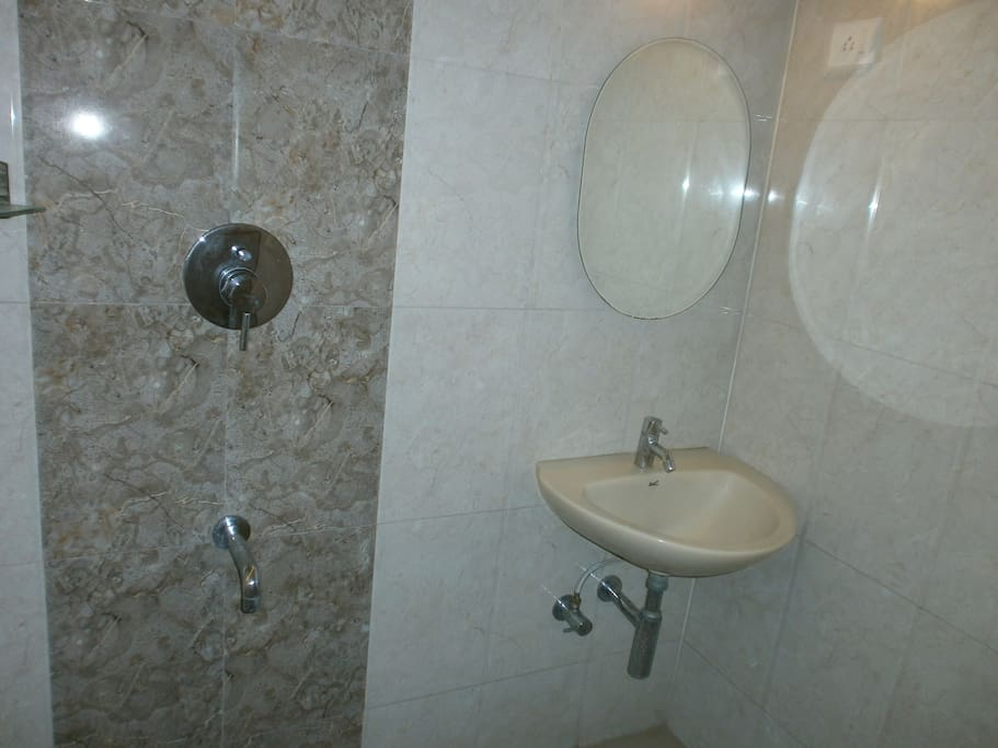 5 Star Hotel type bathroom recently refurbished with Jaquar fittings and designer wall and floor tiles.