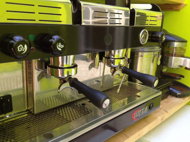 Wake up to freshly ground coffee from our traditional hand pulled espresso machine.