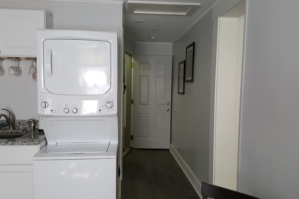 Entrance hallway, large closet with bureau.
