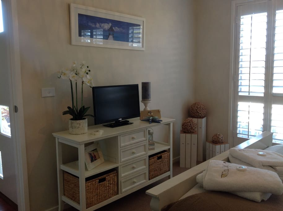 Additional TV and DVD player in main bedroom.