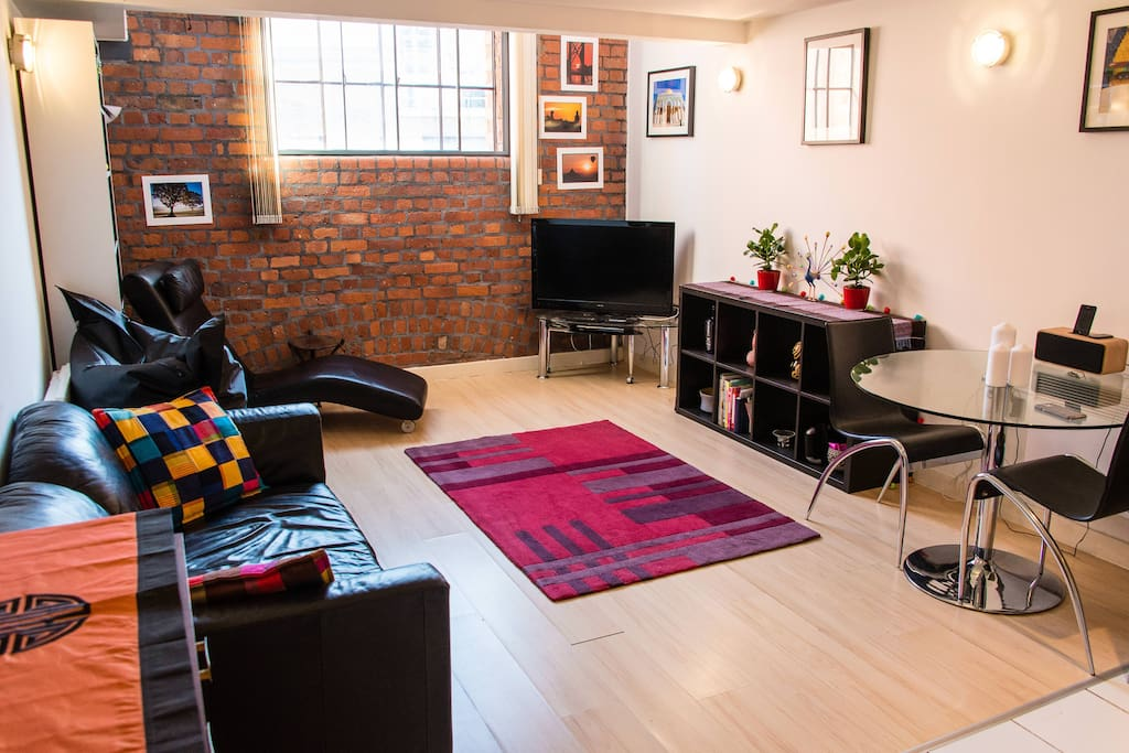 The lounge and kitchen area - with exposed brick