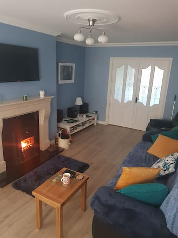 Large living room with wood burning stove. Room for a fold out bed (provided)