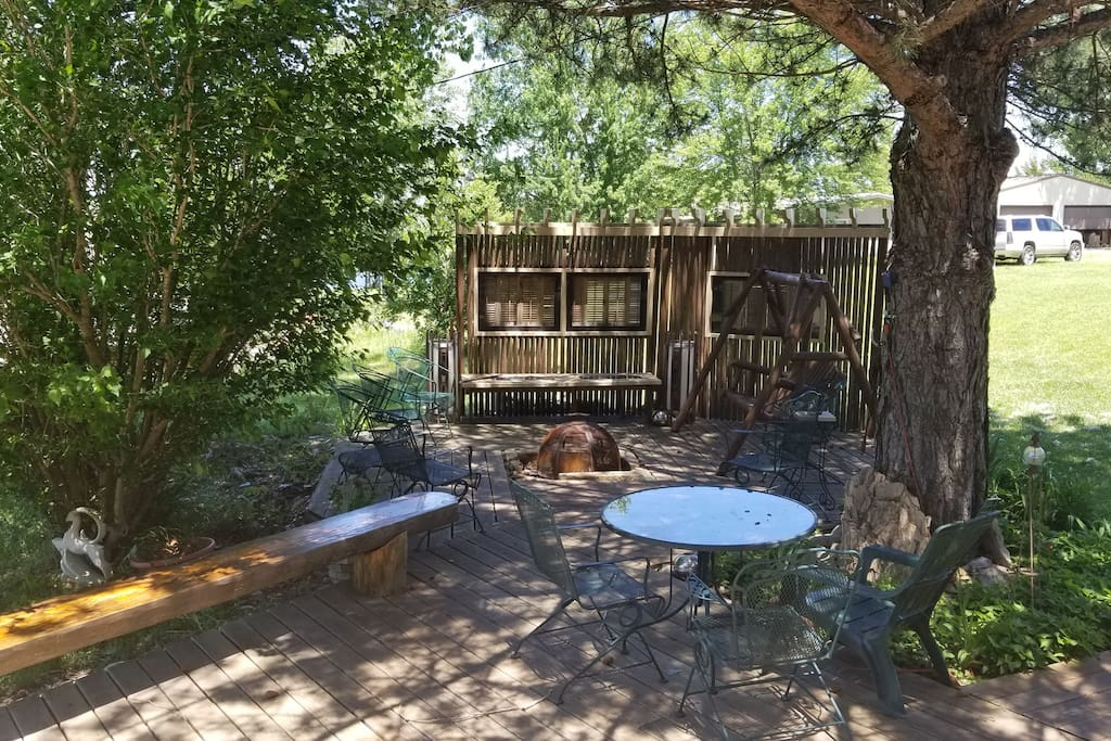 Right outside the bunkhouse is this nice shaded sitting area with a fire pit