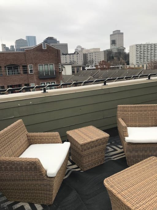 Enormous rooftop deck features views of the skyline and capitol building
