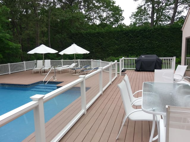Pool Deck with chairs and table for outside eating/cooking with grill