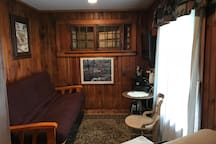 Sitting room with full size futon and twin size futon (bottom right)