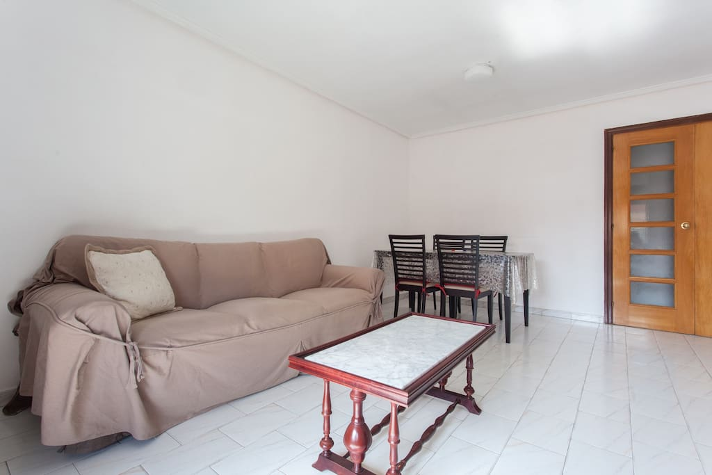 Large and spacious living room with brand new sofa.
