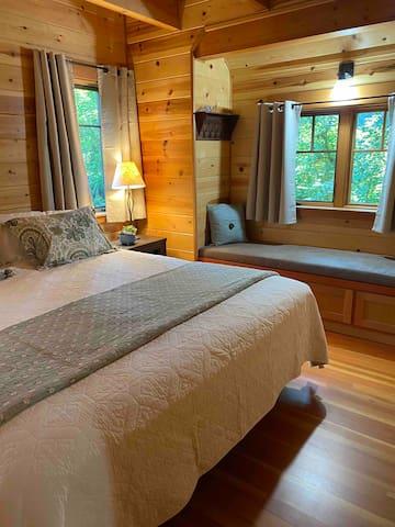 Master bedroom, king size bed, full bath.