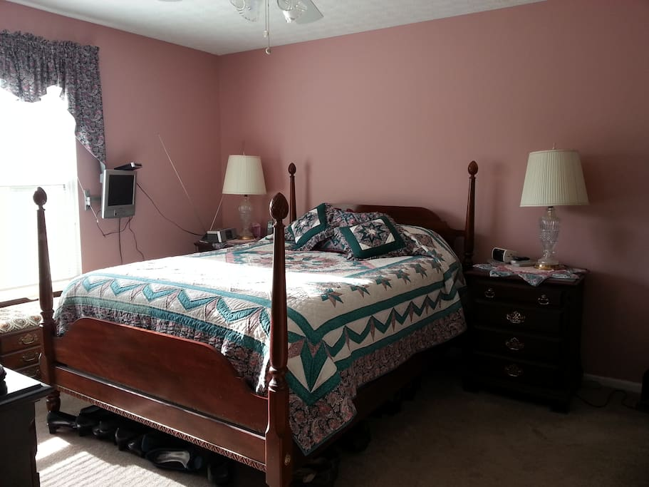 Master BR with queen bed and view of lake