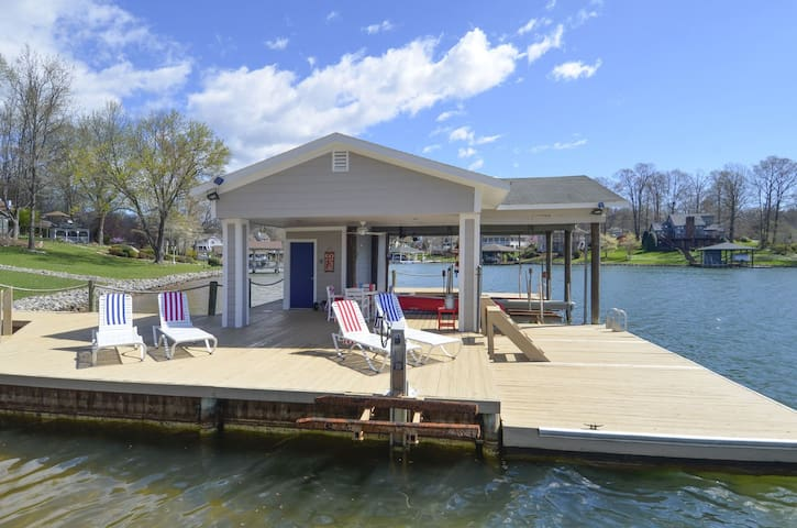 Relax, great lounge chairs and more ..largest dock on the lake, deep water ! next to the beach