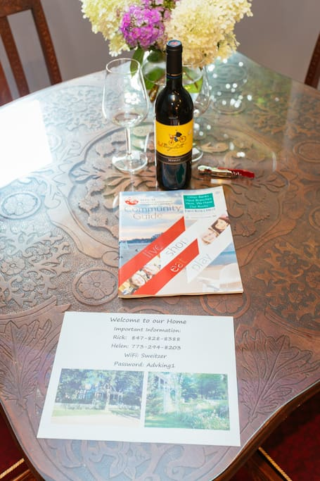 Welcome to our home!  A bottle of wine and a community guide to help you settle in.