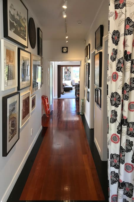 Warm timber floors and lots of art adorn the walls in our home