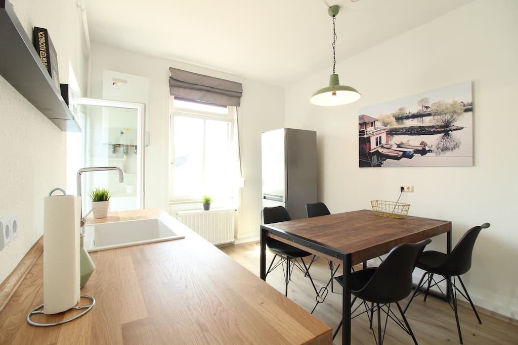 The kitchen has also a dining table & access to the balcony.