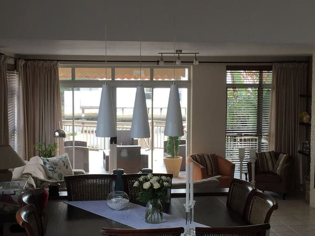 lovely flow from dining area to living area and outside deck