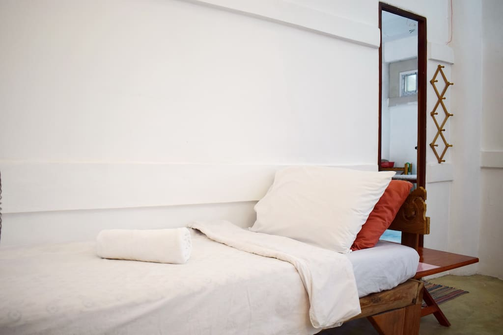 The second single bed; you can see the door to the living space.