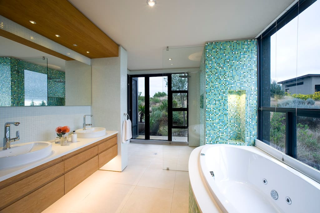 Walk in rain shower and bath with a view