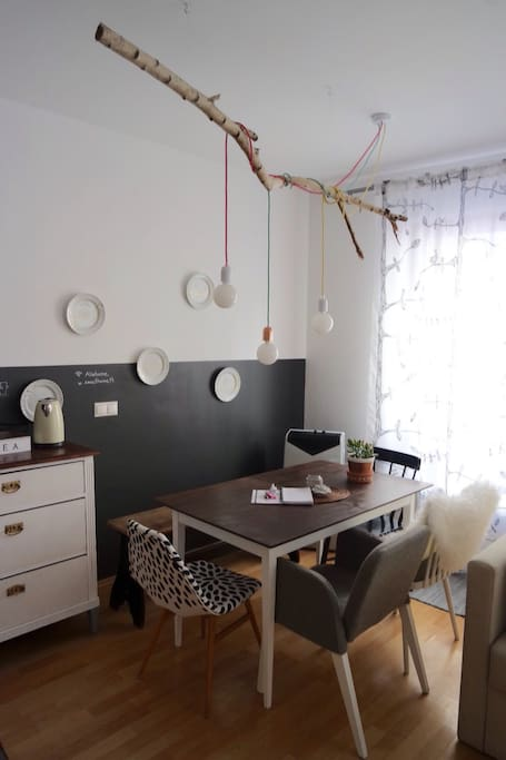 Dining area with renovated furnitures and hungarian desing lamps (Tilka)